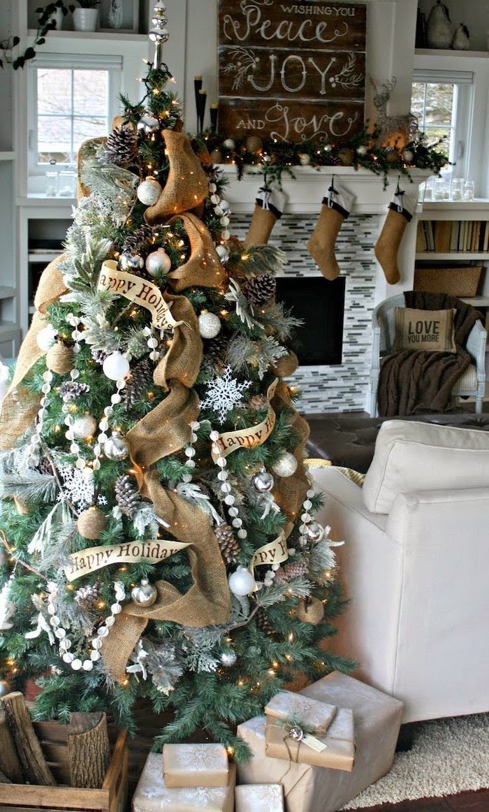 gold ribbons and ornaments on tree, how to put ribbon on a christmas tree, wrapped presents underneath, next to a sofa