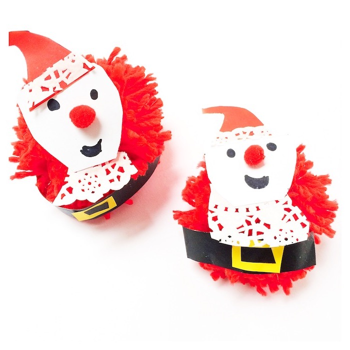 snowmen made of pompoms, red white and black carton, christmas craft ideas for kids, placed on white surface