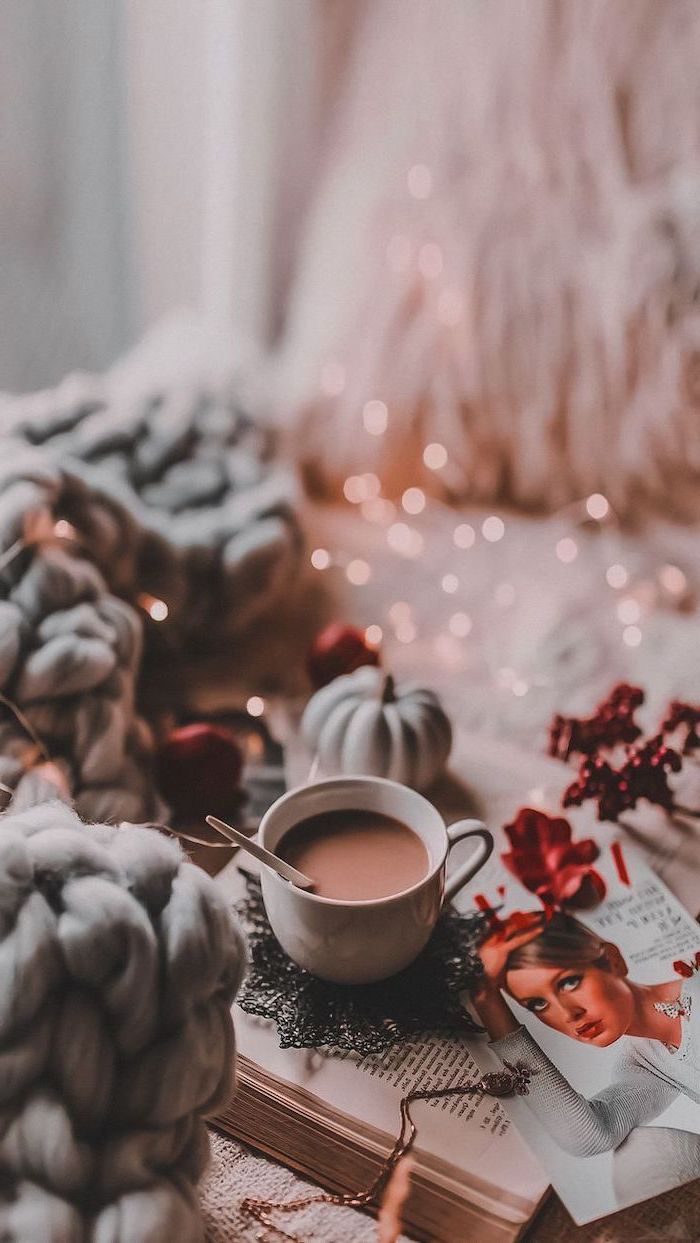 hot chocolate, placed on book on bed, cool desktop backgrounds, grey knitted blanket, fairy lights on the bed