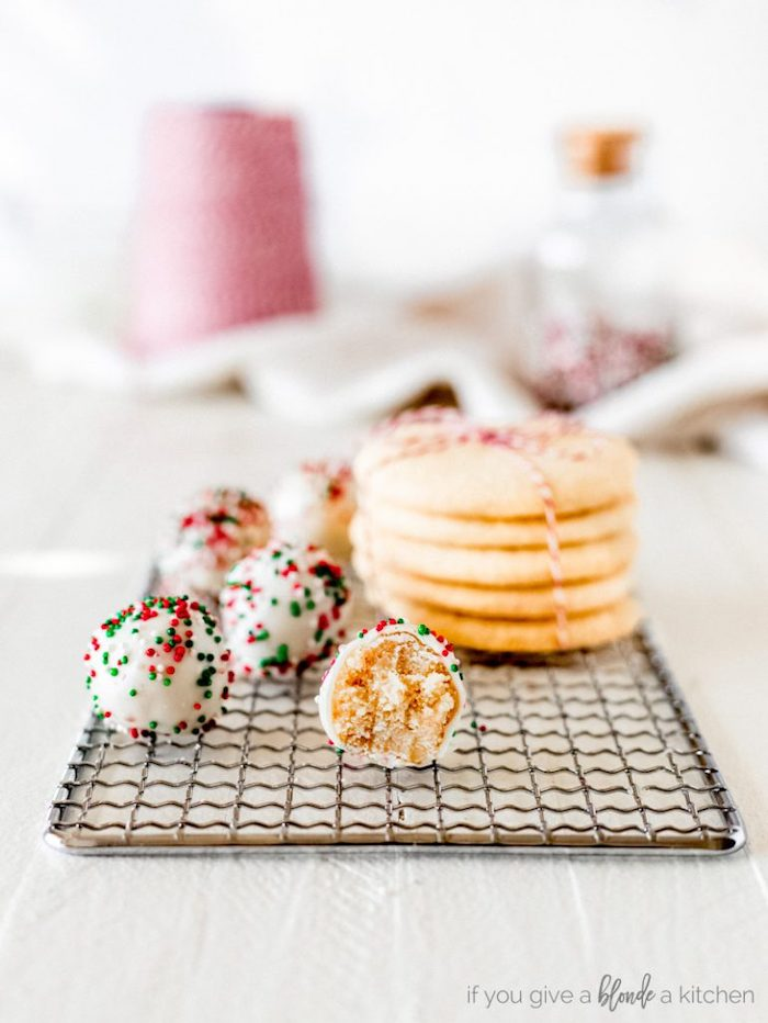 truffles covered with white icing, red green and white sprinkles, arranged on metal rail, cookie icing recipe