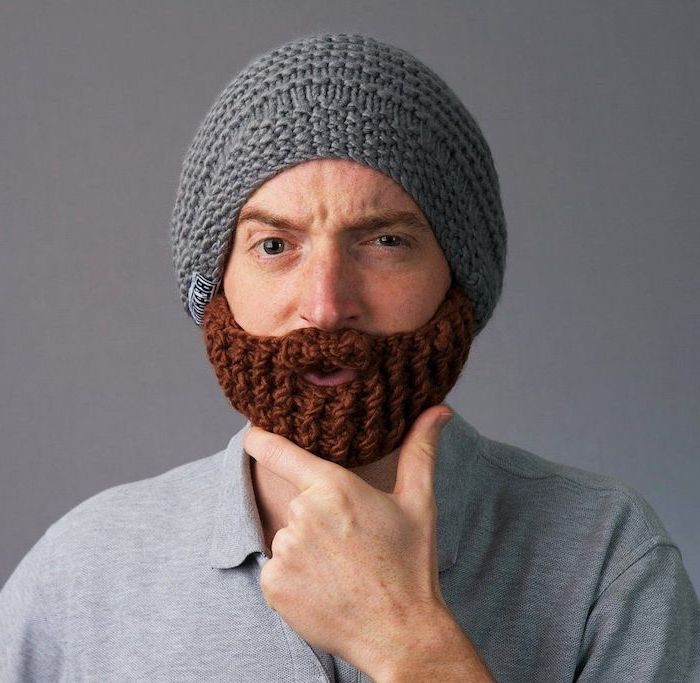 man wearing a grey knitted beard beanie, unique gifts for men, wearing grey t shirt, grey background