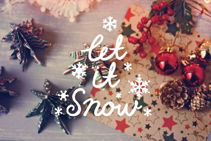 let it snow written over wooden surface, with origami christmas trees, winter desktop backgrounds, baubles pinecones and wrapping paper