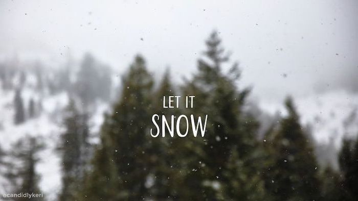 let it snow written over forest landscape, winter desktop backgrounds, tall trees in the background, snow falling
