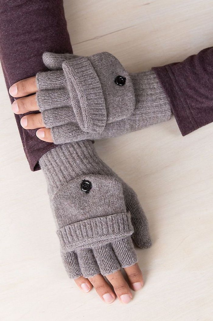 christmas presents for boyfriend, man wearing purple sweater and grey mittens, hands placed on wooden surface
