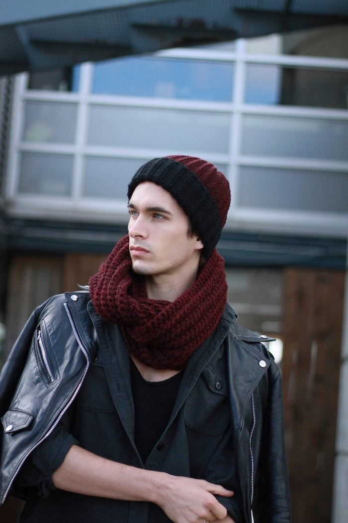 man wearing matching red and black beanie and scarf, black leather jacket, christmas gifts for boyfriend, black jacket and blouse