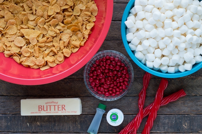 necessary ingredients in large bowls, placed on wooden surface, sugar cookie icing recipe, marshmallows in blue bowl