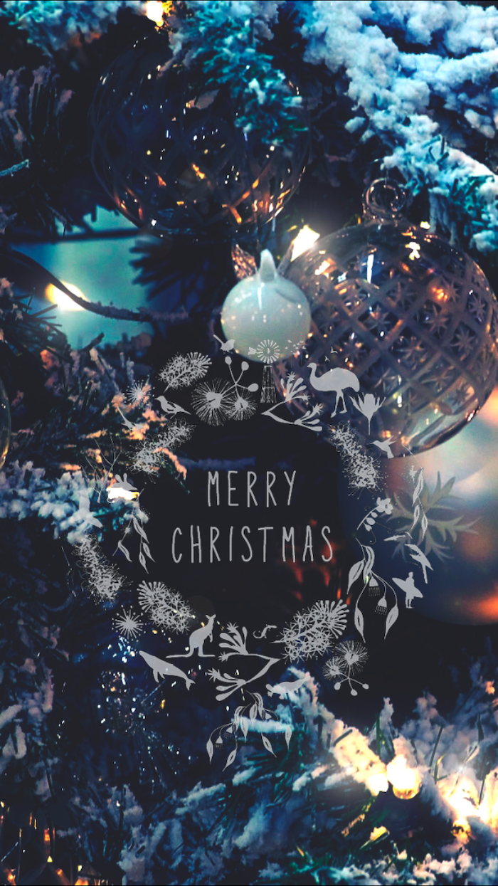 merry christmas written over background, of decorated christmas tree with lights and baubles, screen saver wallpaper