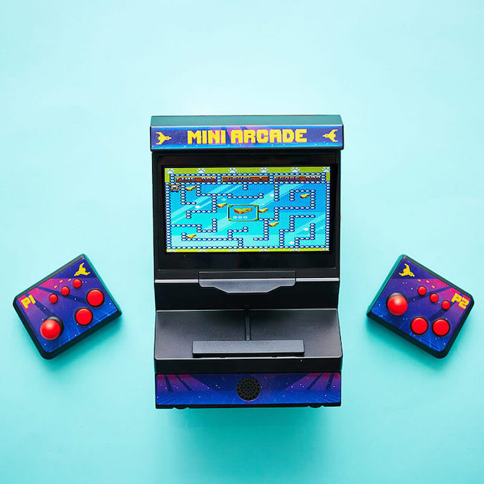 mini arcade game, christmas presents for boyfriend, two joysticks on the side, placed on turquoise surface