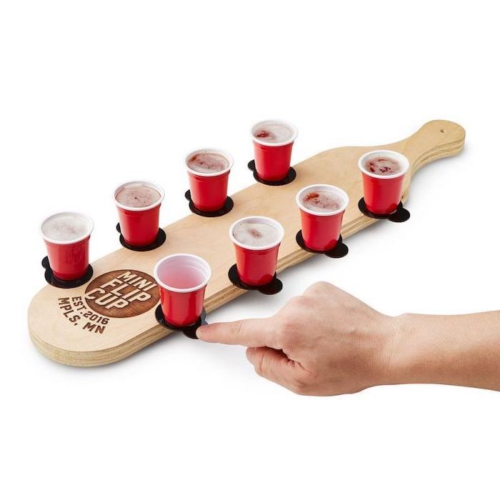 mini flip cup game, christmas presents for boyfriend, wooden board with four red cups on each side, filled with bear