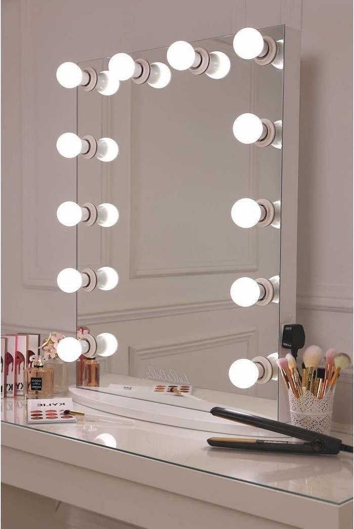hollywood mirror with lights, placed on white vanity with make up on it, christmas gifts for mom from daughter, leaning on white wall