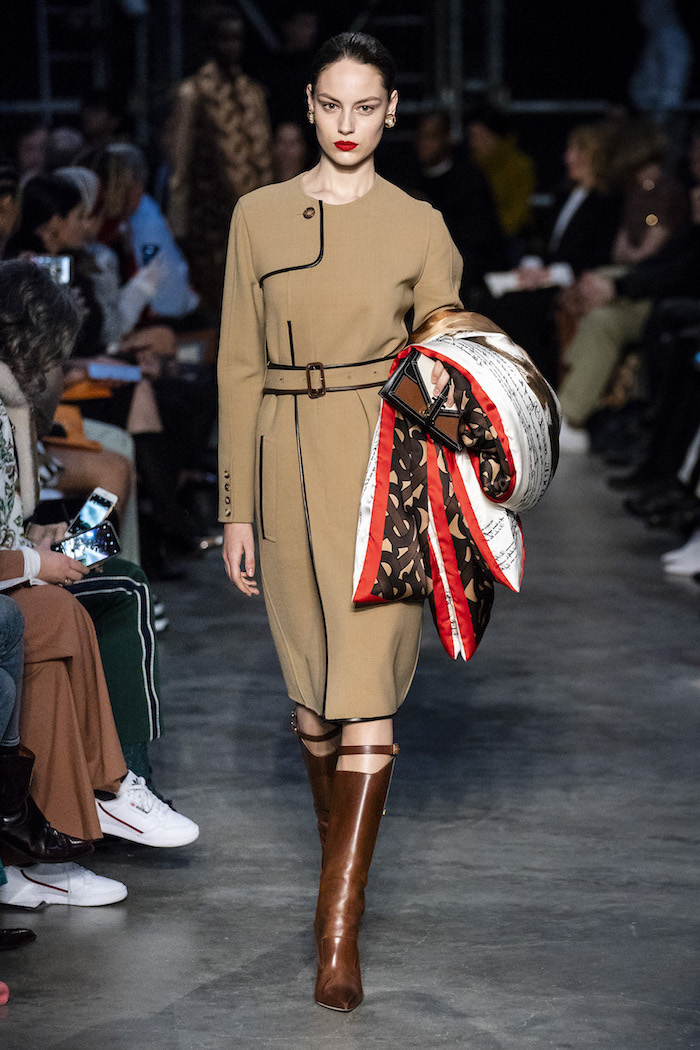 winter fashion for women, model walking down the runway, wearing long beige dress with long sleeves, brown leather boots