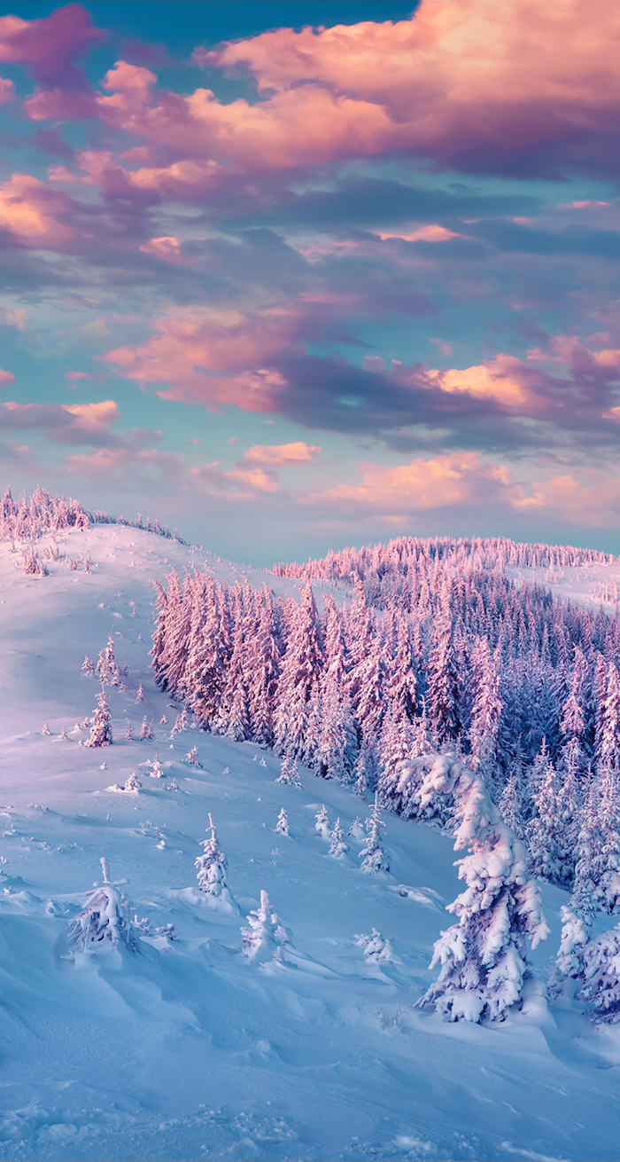 mountain landscape at sunset, desktop backgrounds, lots of trees covered with snow, pink clouds in the sky