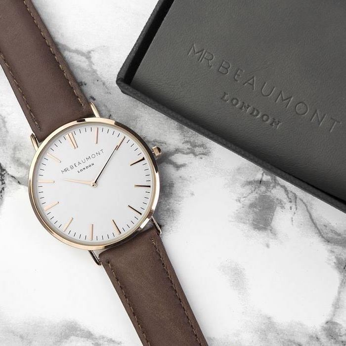 watch with brown leather straps, with nice black leather box, good gifts for boyfriend, placed on marble surface