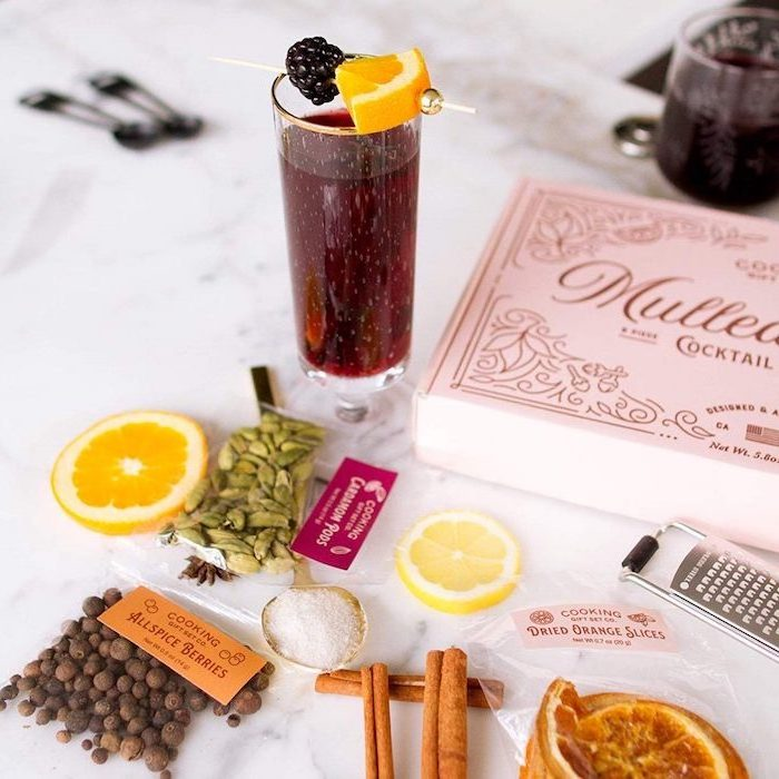 mulled wine cocktail set in a carton box, christmas gift ideas for mom, cinnamon sticks berries and dries orange slices