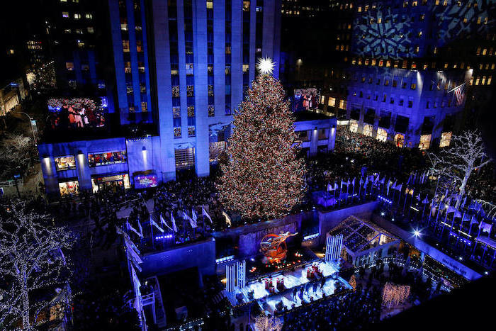 how to decorate a christmas tree, people standing at the lightning ceremony, rockefeller center christmas tree
