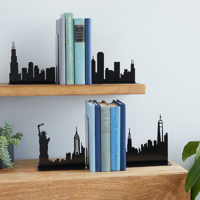 books placed in the middle of bookends, placed on wooden shelves, christmas gifts for mom from daughter, white wall