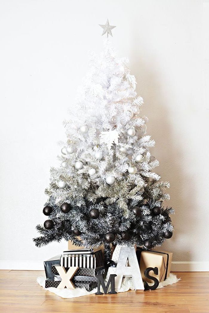 black and white ombre faux tree, wrapped presents underneath, decorating christmas tree with ribbon, decorated with black and white ornaments