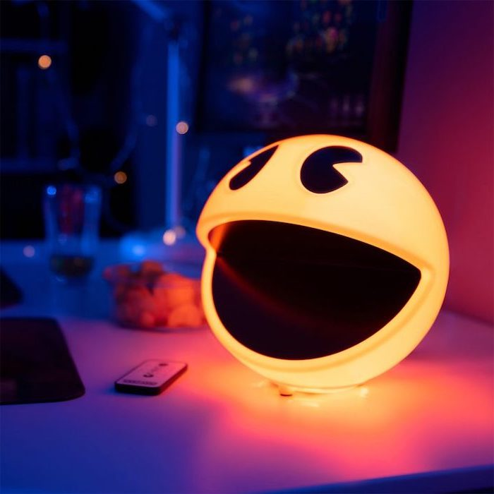pac man shaped lights, placed on bed side table, good gifts for boyfriend, blurred background