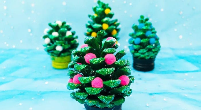 pinecones painted green, colorful pompoms glued to it, diy christmas ornaments for kids, pinecone christmas trees