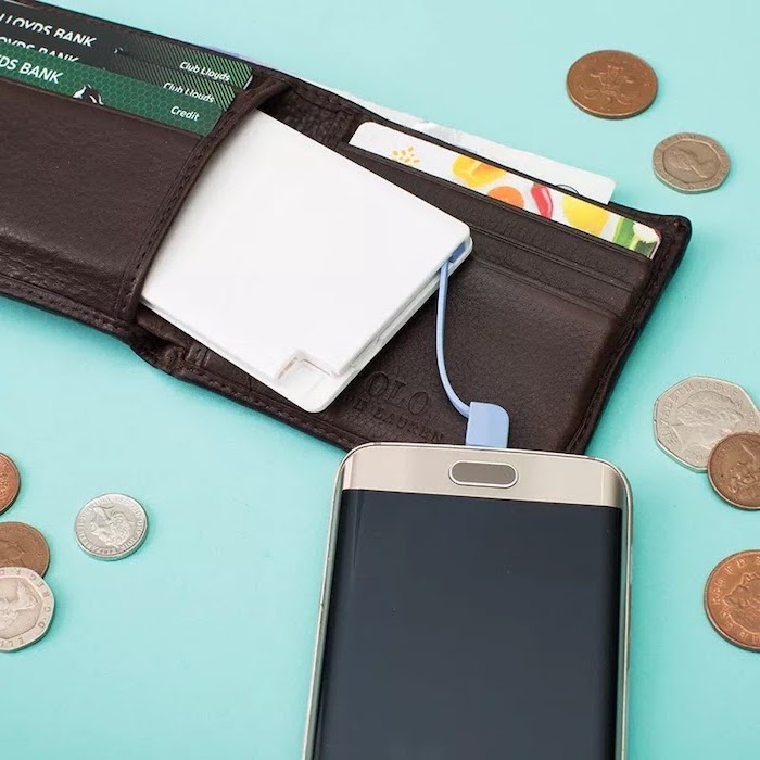 white power bank fitting inside a wallet, creative gifts for boyfriend, coins scattered around turquoise surface