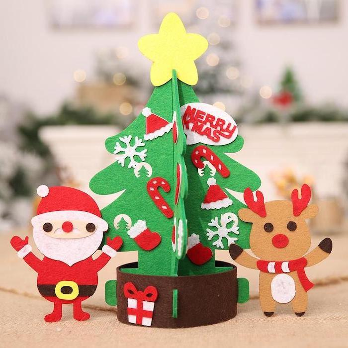 christmas tree santa and reindeer, made of felt, christmas arts and crafts, placed on white surface