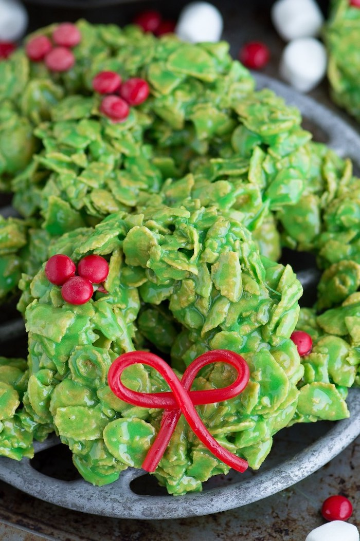 wreath shaped cookies, no bake cookies, sugar cookie icing recipe, placed in grey bowl on grey surface
