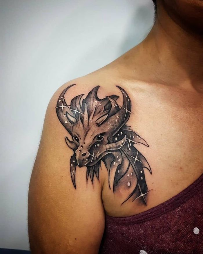 white background, dragon tattoos for women, shoulder tattoo, woman wearing red burgundy top