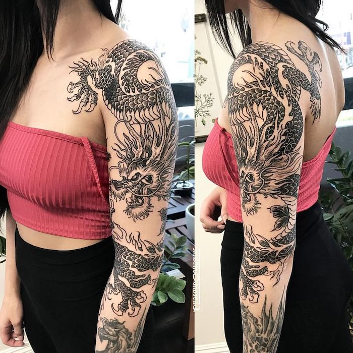 woman wearing red crop top and black pants, large sleeve tattoo of a dragon, dragon tattoos for women, black hair
