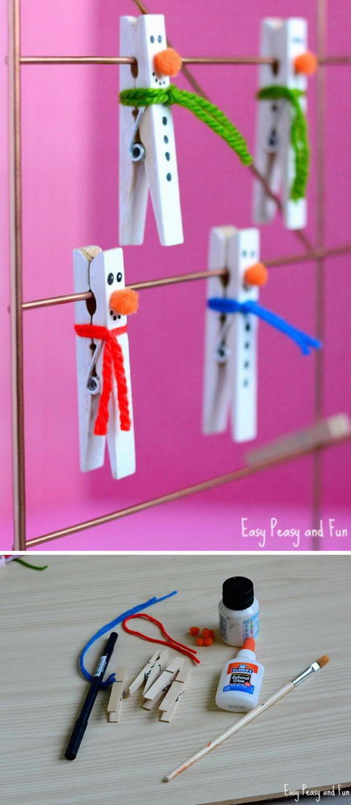 diy ornaments for kids, clothespins turned into snowmen, painted in white, yarn used for scarfs, hanging on metal rail