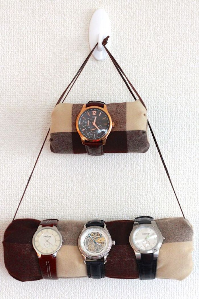 watch holder mounted on white wall, step by step diy tutorial, gift ideas for boyfriend, brown leather straps, four watches on it
