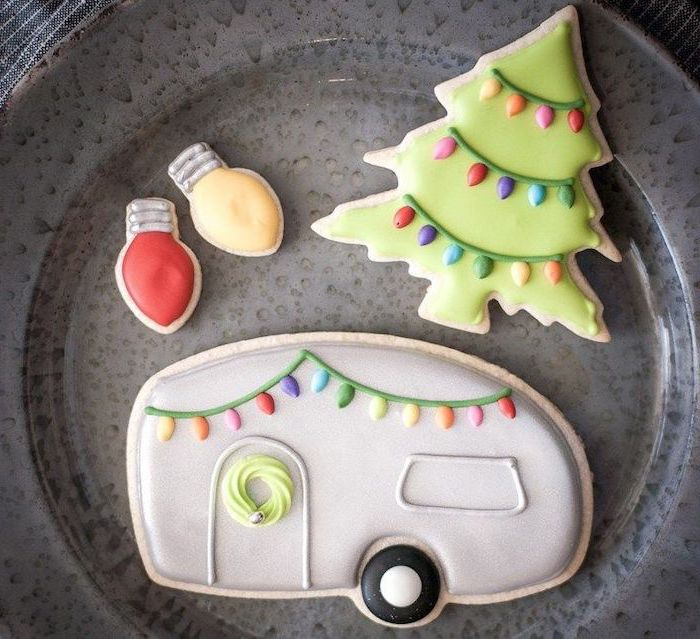 royal icing recipe for sugar cookies, cookies in the shape of caravan and christmas tree and lights, placed on grey plate