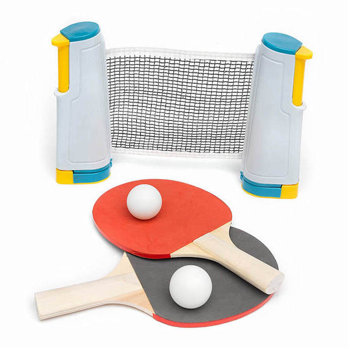 thoughtful christmas gifts for boyfriend, table pong set, net paddles and balls, placed on white surface