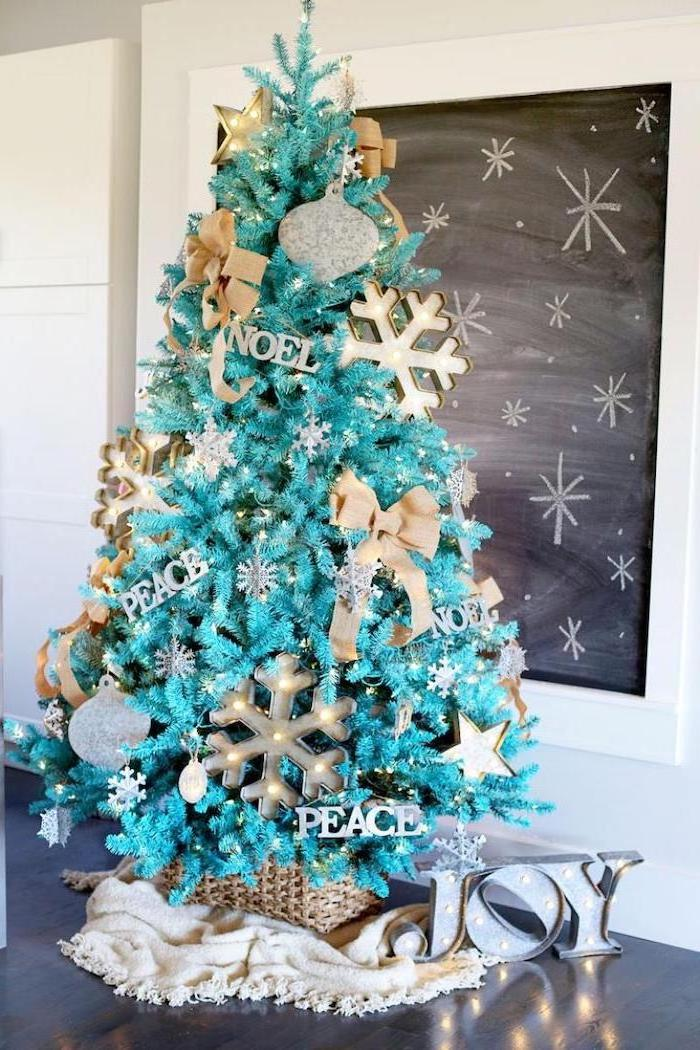 turquoise faux tree, decorated with silver ornaments, gold bows and large snowflakes with lights, tree decorating ideas