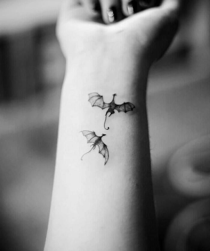 two flying dragons, wrist tattoo, dragon forearm tattoo, black and white photo