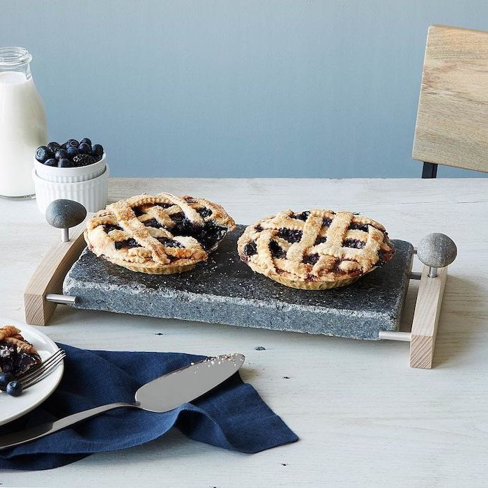meaningful gifts for mom, serving platter made of stone and wood, two pies on it, placed on wooden table