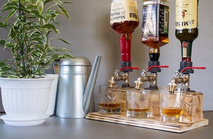 alcohol dispenser with three taps, whiskey bottles mounted on it, thoughtful christmas gifts for boyfriend, made of wood