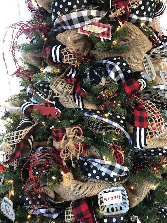 christmas decorations indoor ideas, faux tree decorated with black and white and gold ribbons, red presents ornaments