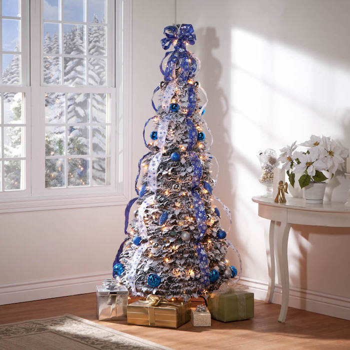 blue and silver ribbons wrapped around a tree, christmas decorations indoor ideas, silver and blue ornaments, wrapped presents underneath