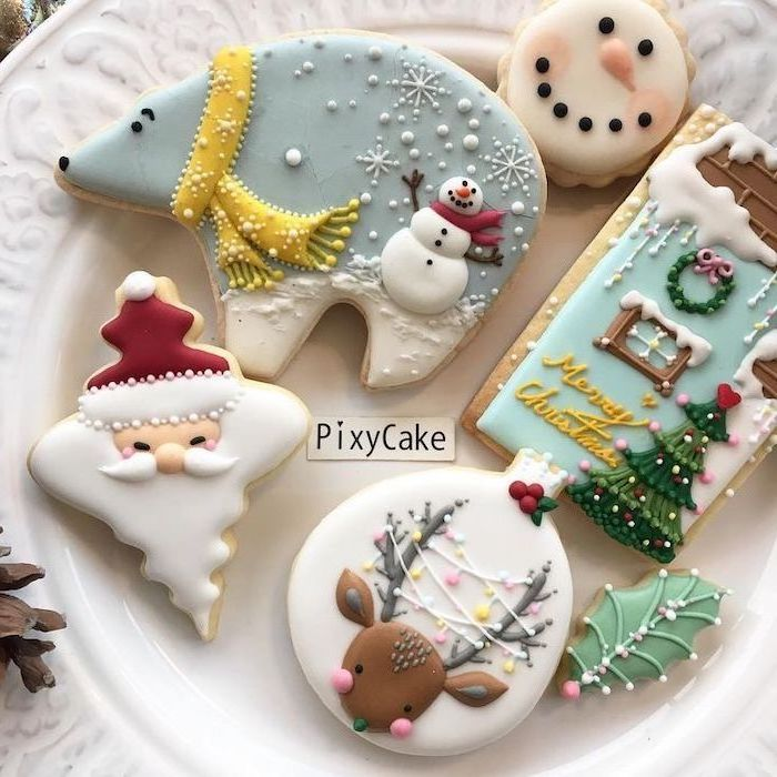 cookies in different shapes, placed on white plate, royal icing recipe for sugar cookies, bear and santa shaped cookies