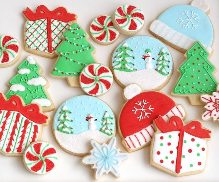 how to make royal icing for cookies, cookies in different shapes, decorated with colorful icing, placed on white surface
