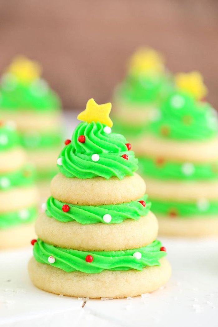 cookies stacked together with green frosting, how to make royal icing for cookies, gold star on top with sprinkles