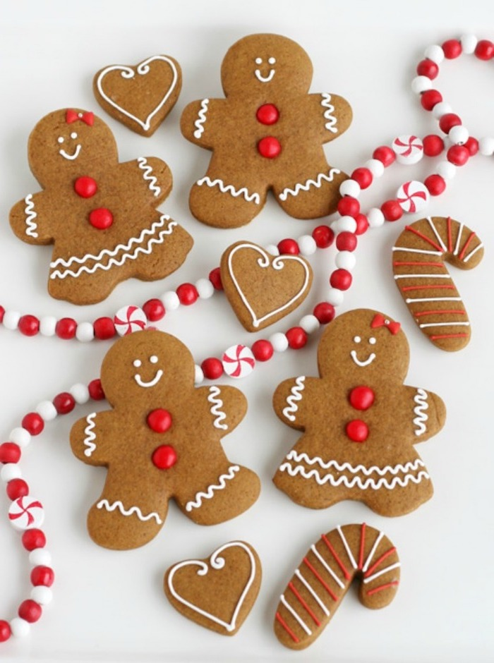 gingerbread men and women, decorated with white icing and red sprinkles, how to make royal icing for cookies
