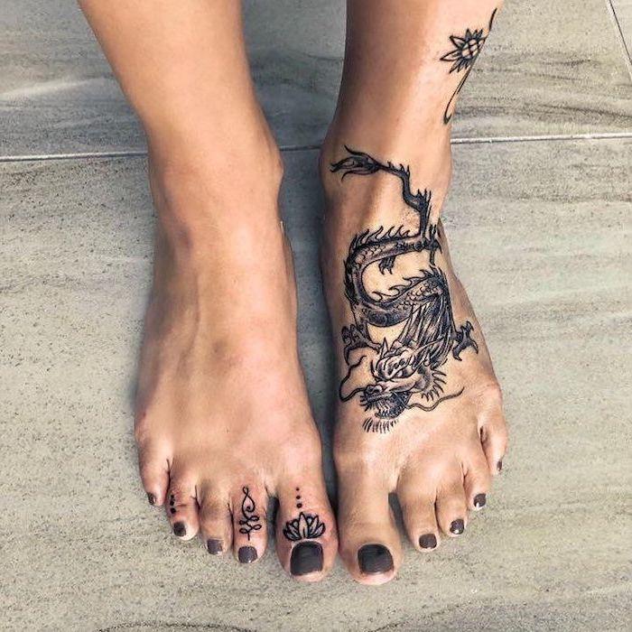 leg tattoo, woman with grey nail polish, dragon tattoo design, white tiled floor