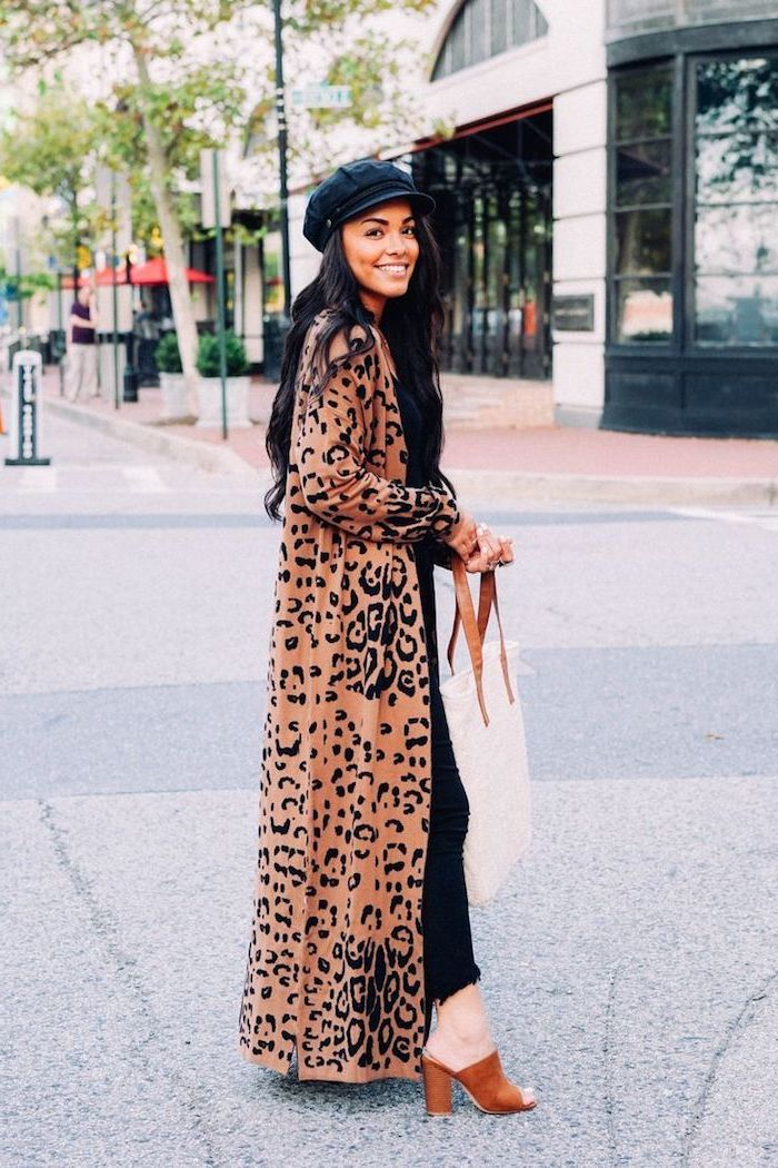 woman standing in the middle of the street, clothing trends 2019, wearing long leopard print coat, open toe shoes