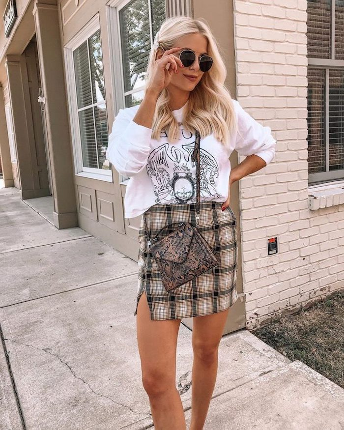 woman with blonde hair, wearing plaid skirt, fall styles for women, white blouse and snake skin print leather bag