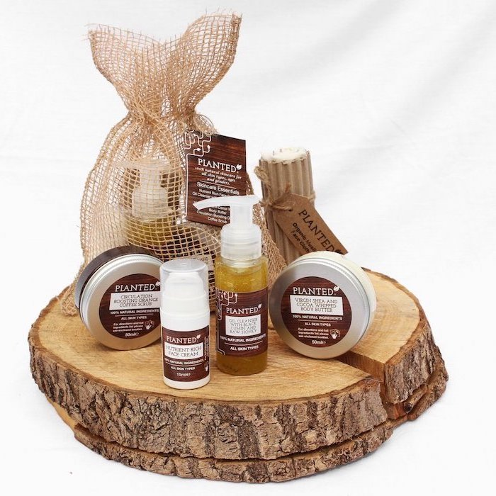 set of skin care products, arranged on wooden log, meaningful gifts for mom, white background