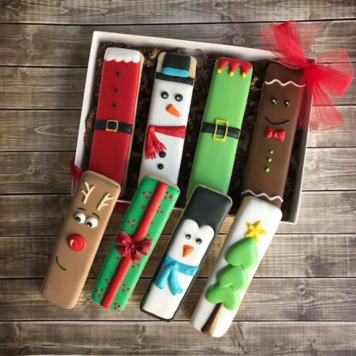 cookies with different decorations, made with colorful icing, arranged in box, how to make royal icing for cookies, placed on wooden surface
