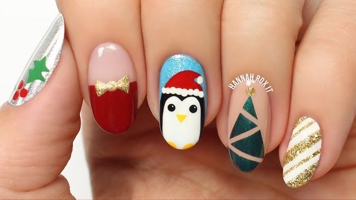 winter nail colors, almond shaped nails, different decorations on each nail, penguin christmas tree and mistletoe