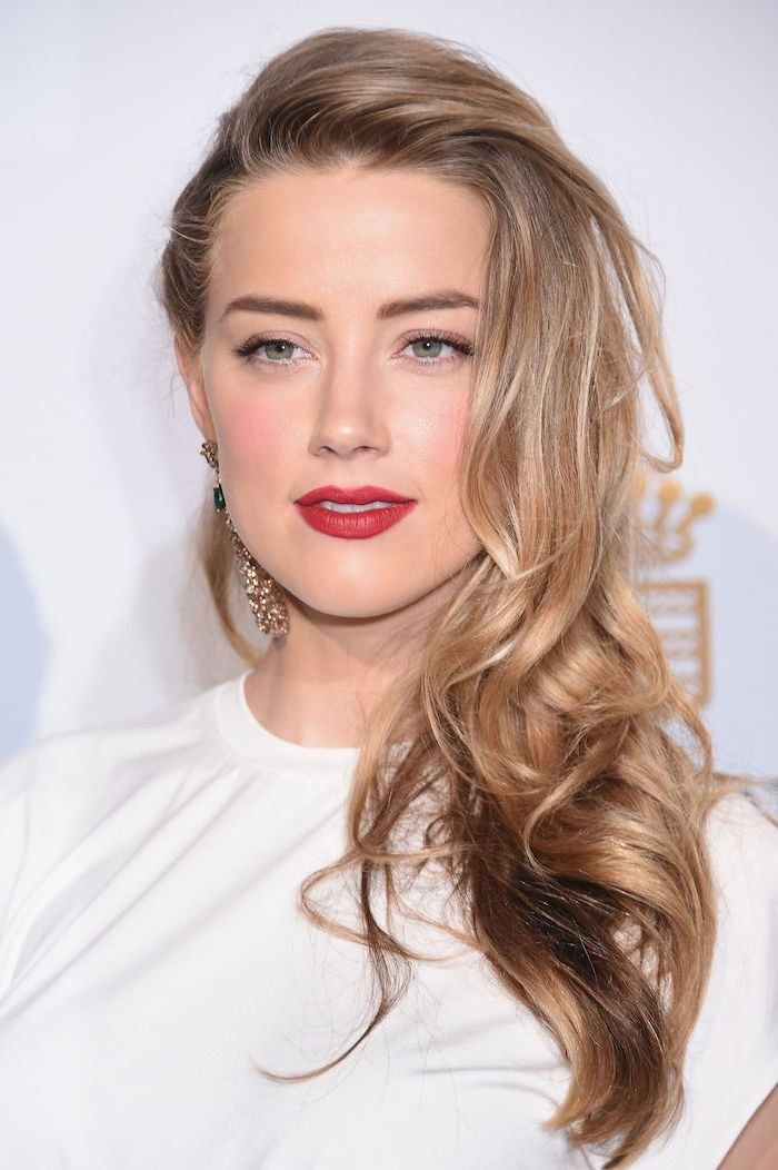 2020 hair color trends for brunettes, amber heard with blonde hair, long wavy hair, wearing white dress