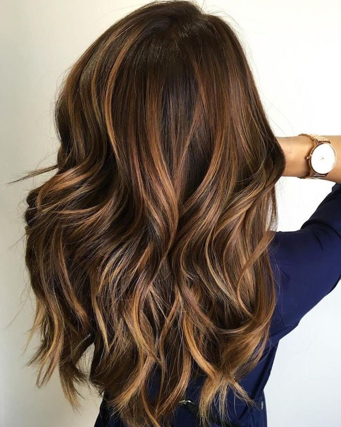 woman wearing blue shirt, 2020 hair color trends for brunettes, balayage brown hair with highlights, long wavy hair